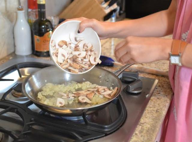 adding mushrooms to sauteed onions