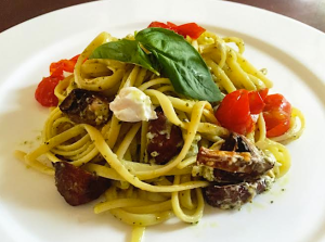 pesto linguini with roasted tomatoes, mushrooms, and goat cheese